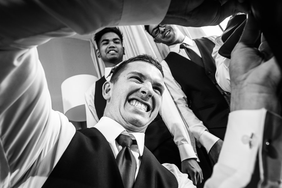 Groomsmen dressing Groom, black and white, Holiday Inn Express Pensacola Downtown, Pensacola Summer Wedding, Lazzat Photography