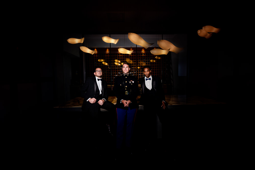 Groom and Groomsmen in a dark room Pensacola Beach Military Wedding, Hilton Pensacola Beach, Lazzat Photography, Florida Wedding Photography