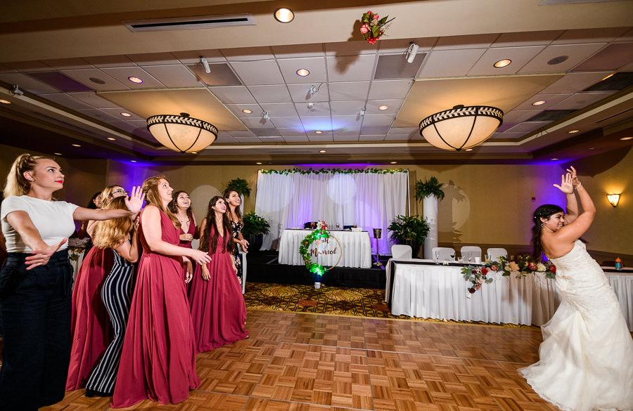 Bride tossing the bouquet, Hilton Garden Inn Pensacola Airport, Pensacola Summer Wedding, Lazzat Photography