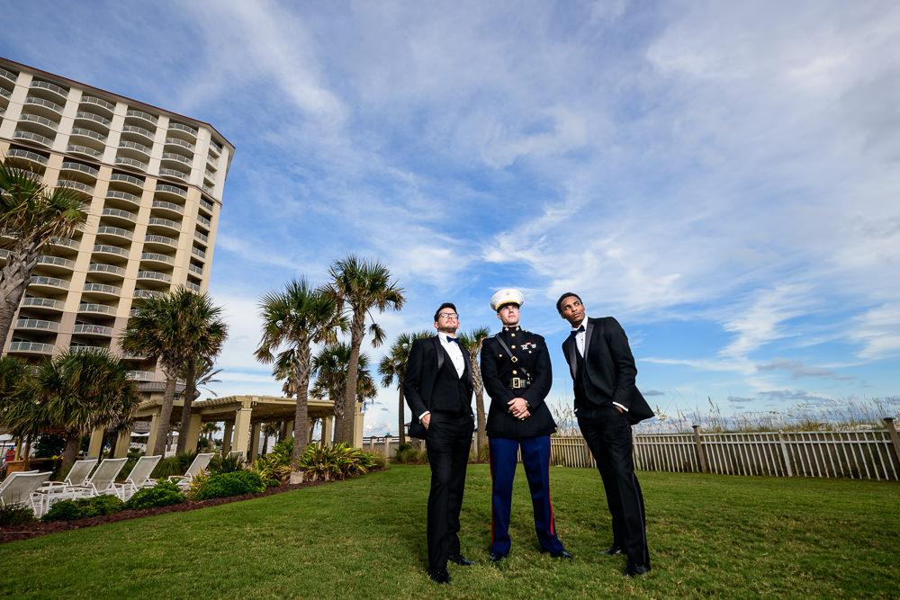 Groom and Groomsmen looking into the distance outside, Pensacola Beach Military Wedding, Hilton Pensacola Beach, Lazzat Photography, Florida Wedding Photography