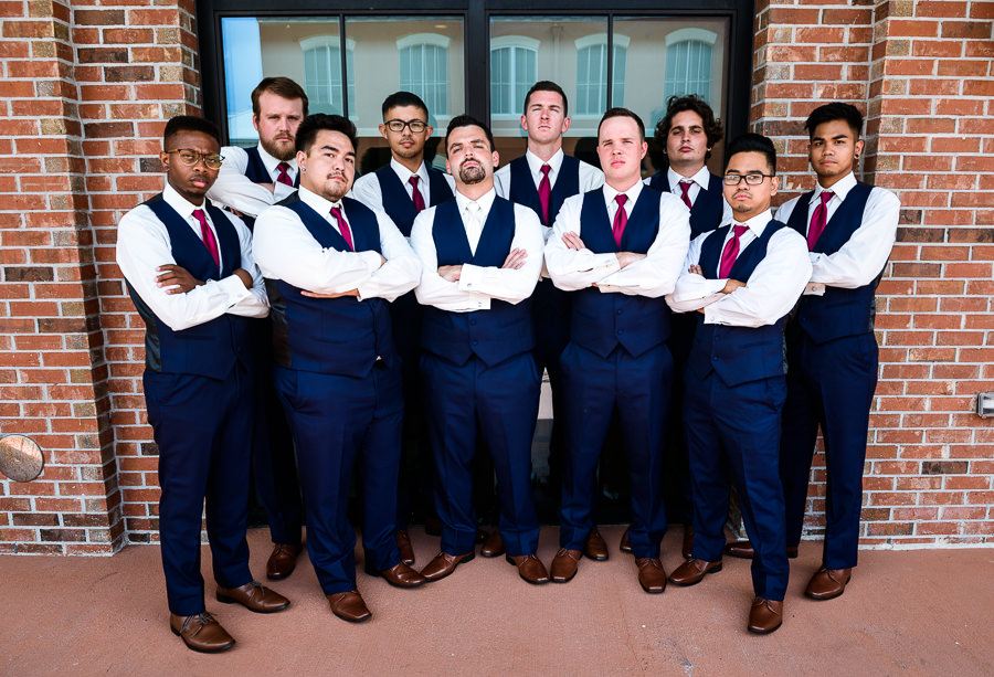Groom looking tough with groomsmen, Blue and pink wedding, Holiday Inn Express Pensacola Downtown, Pensacola Summer Wedding, Lazzat Photography