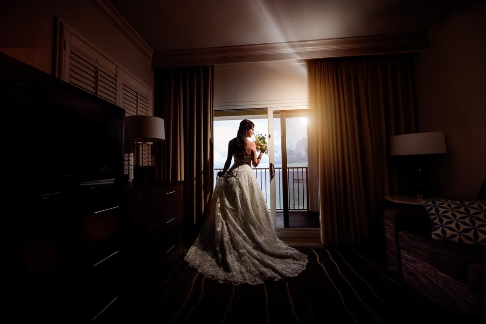 Bridal portrait in front of the window, Pensacola Beach Military Wedding, Hilton Pensacola Beach, Lazzat Photography, Florida Wedding Photography