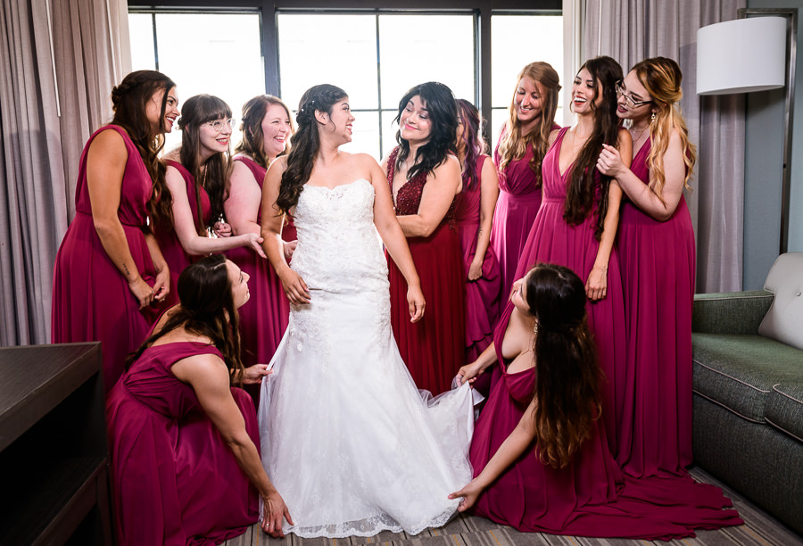 Bride with her mom and Bridesmaids all around her, Magenta bridesmaid dresses, Holiday Inn Express Pensacola Downtown, Pensacola Summer Wedding, Lazzat Photography