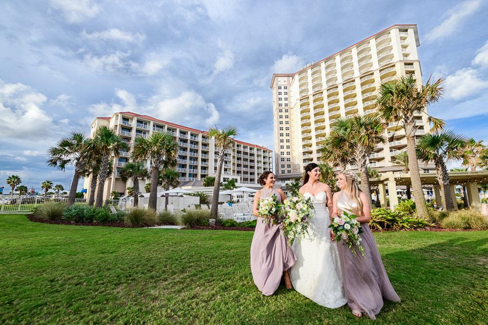 Bride walking with Bridesmaids, Pensacola Beach Military Wedding, Hilton Pensacola Beach, Lazzat Photography, Florida Wedding Photography