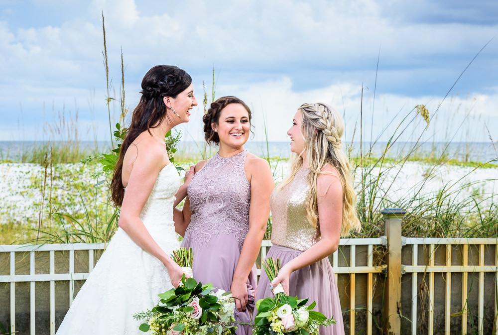 Bride talking with Bridesmaids, Pensacola Beach Military Wedding, Hilton Pensacola Beach, Lazzat Photography, Florida Wedding Photography