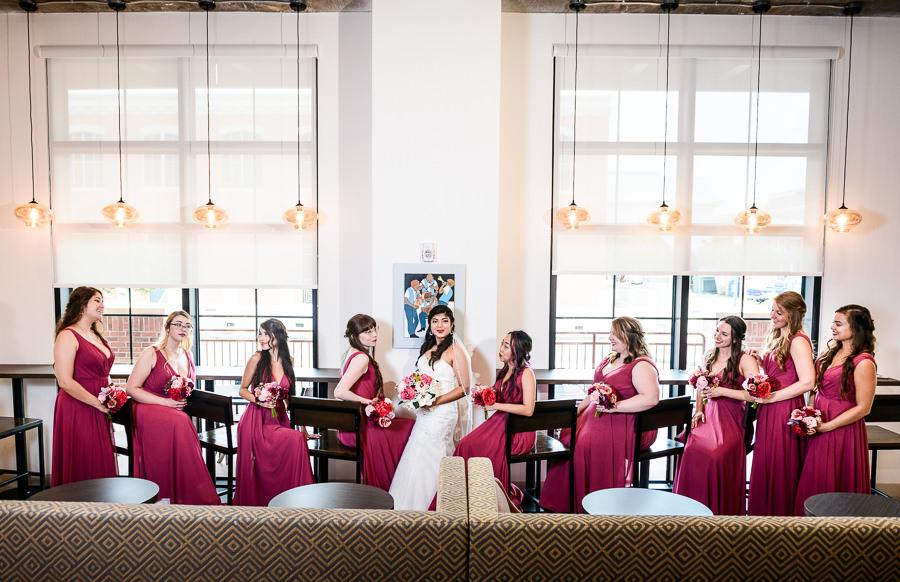 Bride and Bridesmaids on barstools, Magenta bridesmaid dresses, Holiday Inn Express Pensacola Downtown, Pensacola Summer Wedding, Lazzat Photography