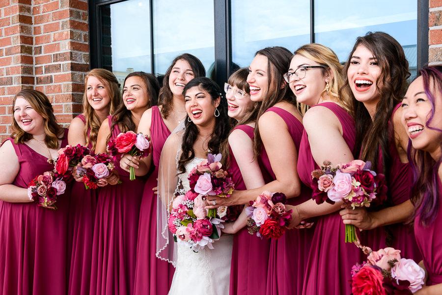Bride laughing with Bridesmaids, Magenta bridesmaid dresses, Holiday Inn Express Pensacola Downtown, Pensacola Summer Wedding, Lazzat Photography