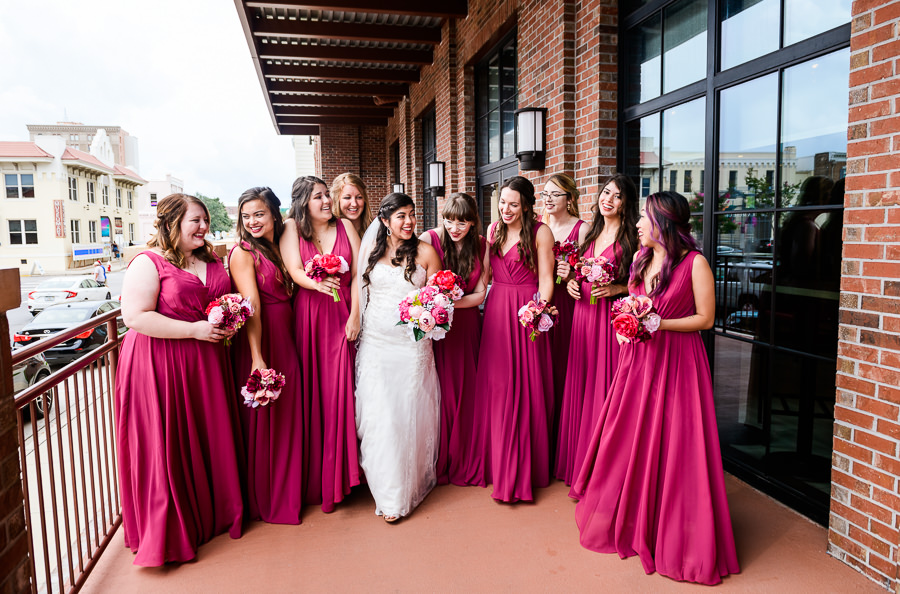 Bride walking with Bridesmaids, Magenta bridesmaid dresses, Holiday Inn Express Pensacola Downtown, Pensacola Summer Wedding, Lazzat Photography