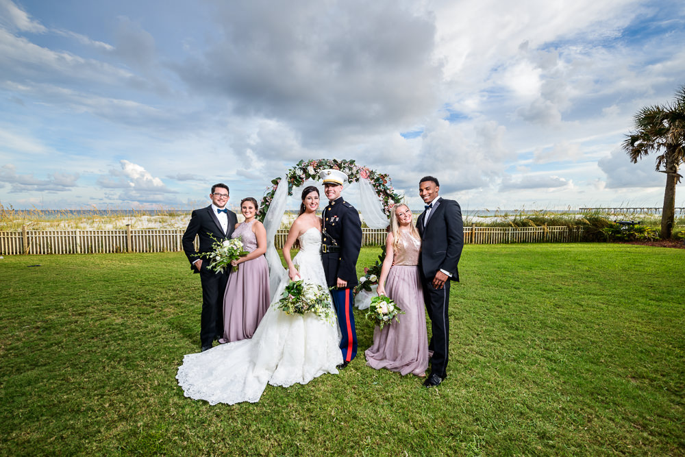 Wedding party in front of wedding arch, Pensacola Beach Military Wedding, Hilton Pensacola Beach, Lazzat Photography, Florida Wedding Photography