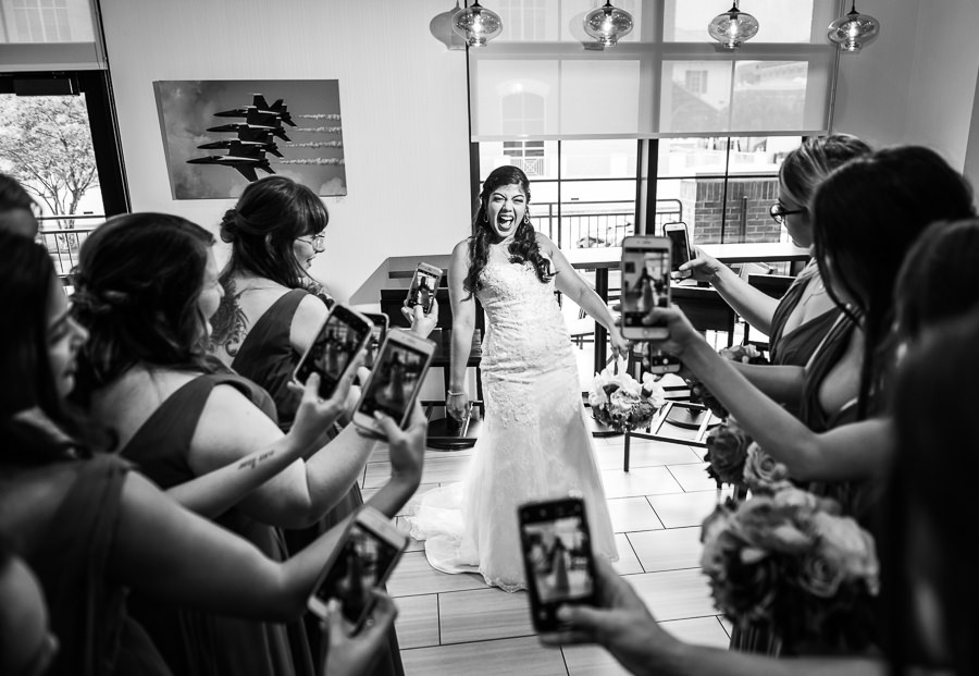 Bridesmaids taking pictures of the Bride, Holiday Inn Express Pensacola Downtown, Pensacola Summer Wedding, Lazzat Photography