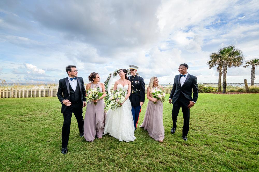 Wedding party walking towards the camera, Pensacola Beach Military Wedding, Hilton Pensacola Beach, Lazzat Photography, Florida Wedding Photography