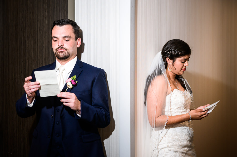 Bride and Groom reading notes during first touch, Holiday Inn Express Pensacola Downtown, Pensacola Summer Wedding, Lazzat Photography