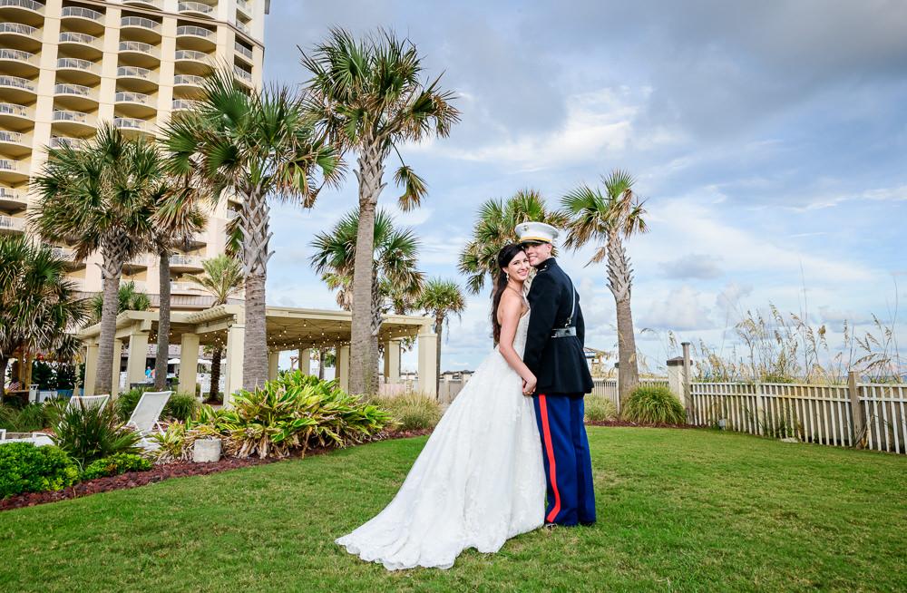 Bride and Groom smiling at the camera outside, Pensacola Beach Military Wedding, Hilton Pensacola Beach, Lazzat Photography, Florida Wedding Photography