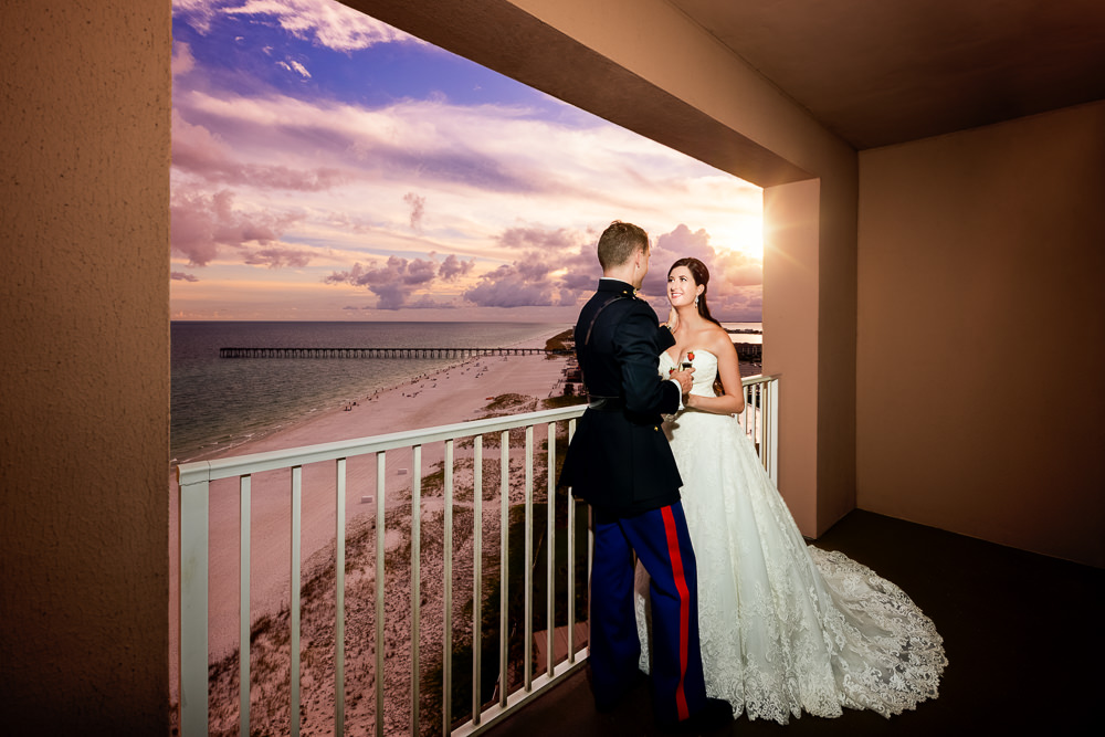 Bride and Groom on the balcony at sunset, Pensacola Beach Military Wedding, Hilton Pensacola Beach, Lazzat Photography, Florida Wedding Photography
