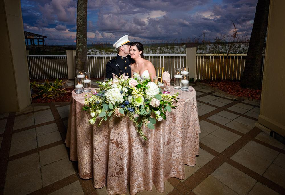 Bride and Groom at their sweetheart table, Pensacola Beach Military Wedding, Hilton Pensacola Beach, Lazzat Photography, Florida Wedding Photography