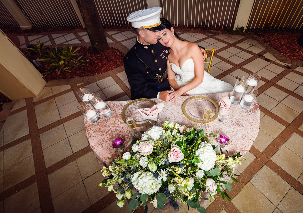 Bride and Groom at their sweetheart table from above, Pensacola Beach Military Wedding, Hilton Pensacola Beach, Lazzat Photography, Florida Wedding Photography