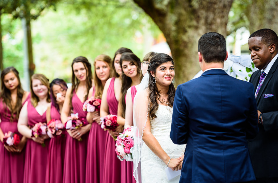 Bride during the ceremony, blue and pink wedding, magenta bridesmaids dresses, seville square, Pensacola Summer Wedding, Lazzat Photography