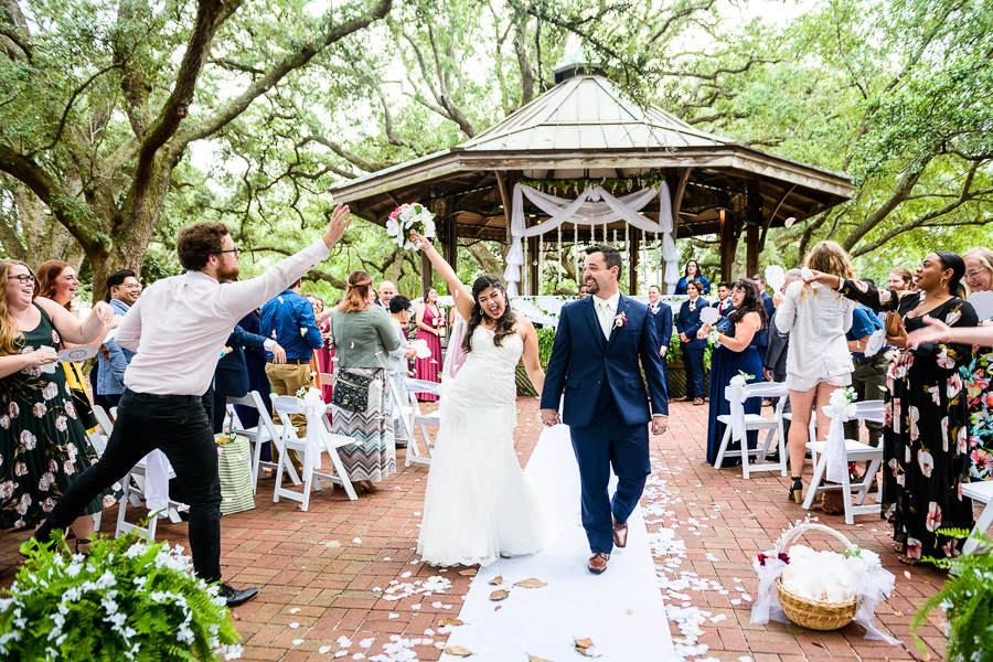 Bride and Groom walking up the aisle, seville square, Pensacola Summer Wedding, Lazzat Photography