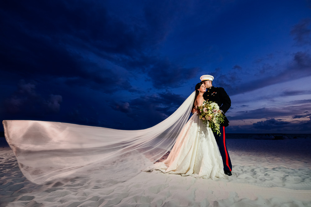 Epic Bride and Groom on the beach at sunset with veil flying, Pensacola Beach Military Wedding, Hilton Pensacola Beach, Lazzat Photography, Florida Wedding Photography