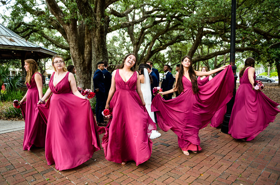 Bridesmaids dancing with their flowy dresses, blue and pink wedding, magenta bridesmaids dresses, seville square, Pensacola Summer Wedding, Lazzat Photography