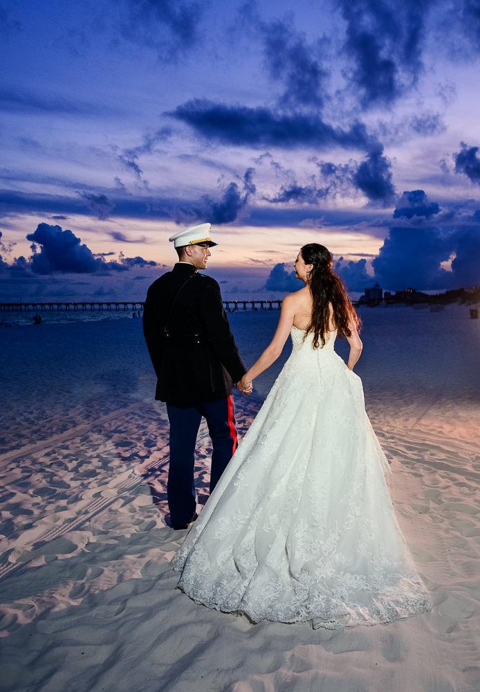 Bride and Groom walking down the beach at sunset, Pensacola Beach Military Wedding, Hilton Pensacola Beach, Lazzat Photography, Florida Wedding Photography