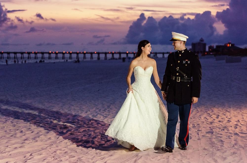 Bride and Groom walking on the beach at sunset, Pensacola Beach Military Wedding, Hilton Pensacola Beach, Lazzat Photography, Florida Wedding Photography