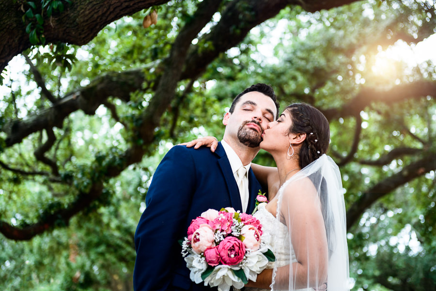 Bride kissing Groom right after the ceremony, seville square, Pensacola Summer Wedding, Lazzat Photography