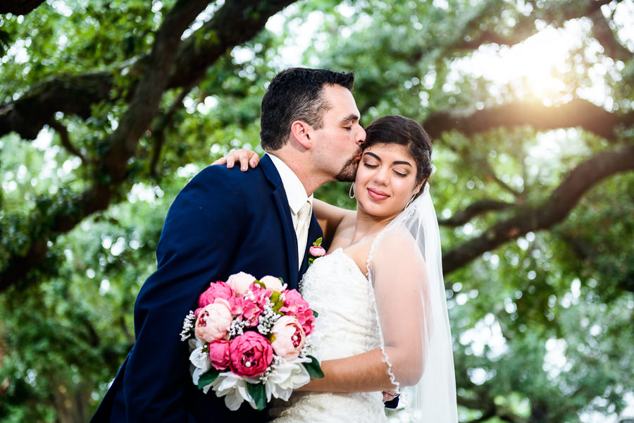 Groom kissing Bride on the head right after the ceremony, seville square, Pensacola Summer Wedding, Lazzat Photography