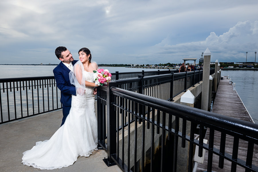 Bride and Groom looking at each other on the Palafox Pier, Pensacola Summer Wedding, Lazzat Photography