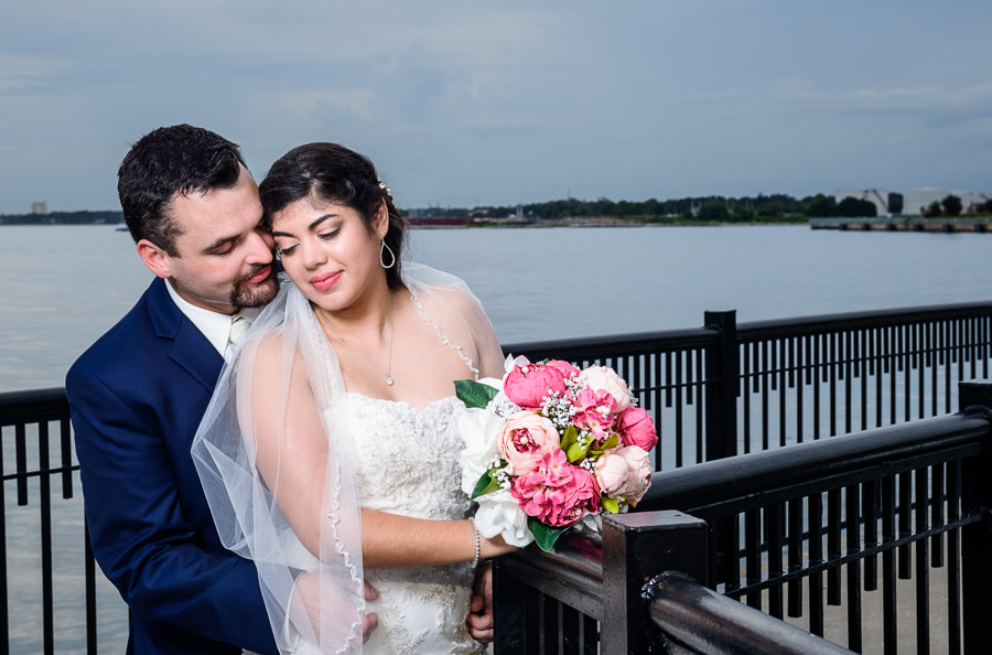 Bride and Groom special moment on the Palafox Pier, Pensacola Summer Wedding, Lazzat Photography
