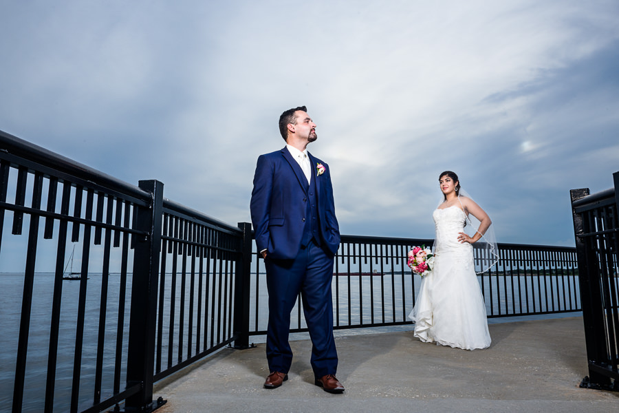 Bride looking at Groom on the Palafox Pier, Pensacola Summer Wedding, Lazzat Photography