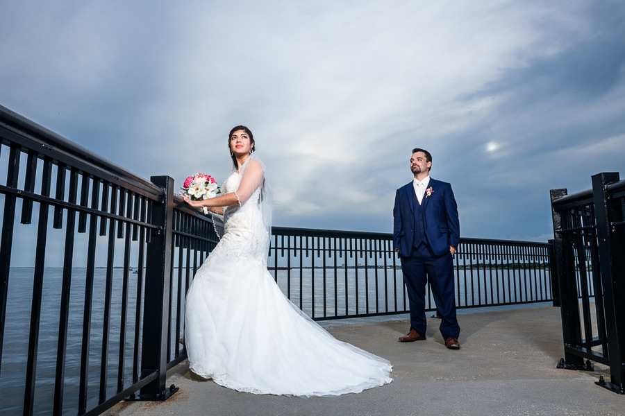 Groom looking at Bride on the Palafox Pier, Pensacola Summer Wedding, Lazzat Photography