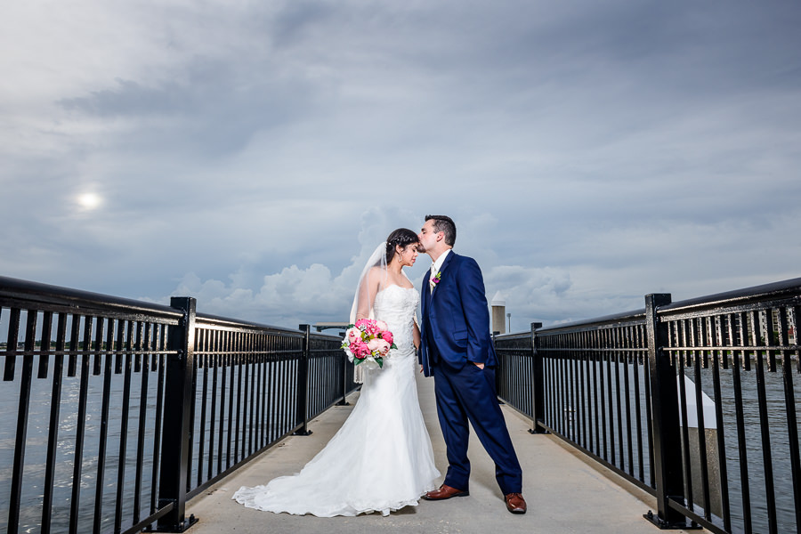 Groom kissing Bride on the head on the Palafox Pier, Pensacola Summer Wedding, Lazzat Photography