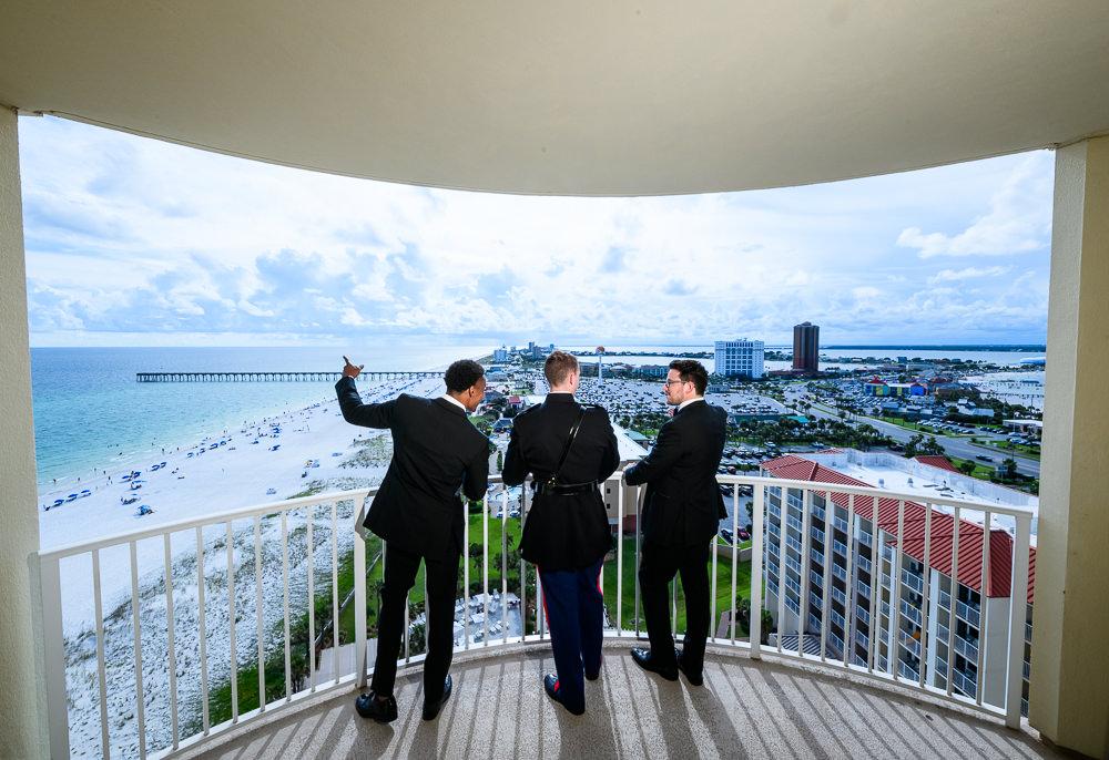 Groom and Groomsmen talking on the balcony, Pensacola Beach Military Wedding, Hilton Pensacola Beach, Lazzat Photography, Florida Wedding Photography