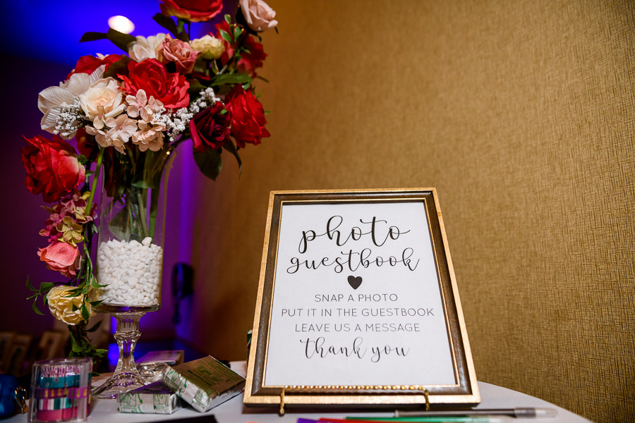Photo guestbook sign with red and pink flowers, Hilton Garden Inn Pensacola Airport, Pensacola Summer Wedding, Lazzat Photography