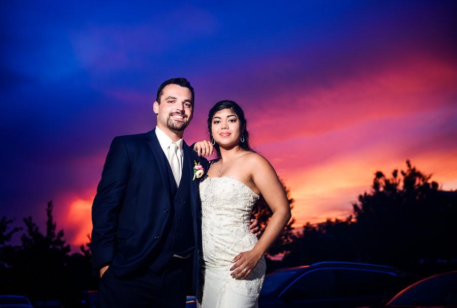 Bride and Groom smiling at sunset, Hilton Garden Inn Pensacola Airport, Pensacola Summer Wedding, Lazzat Photography
