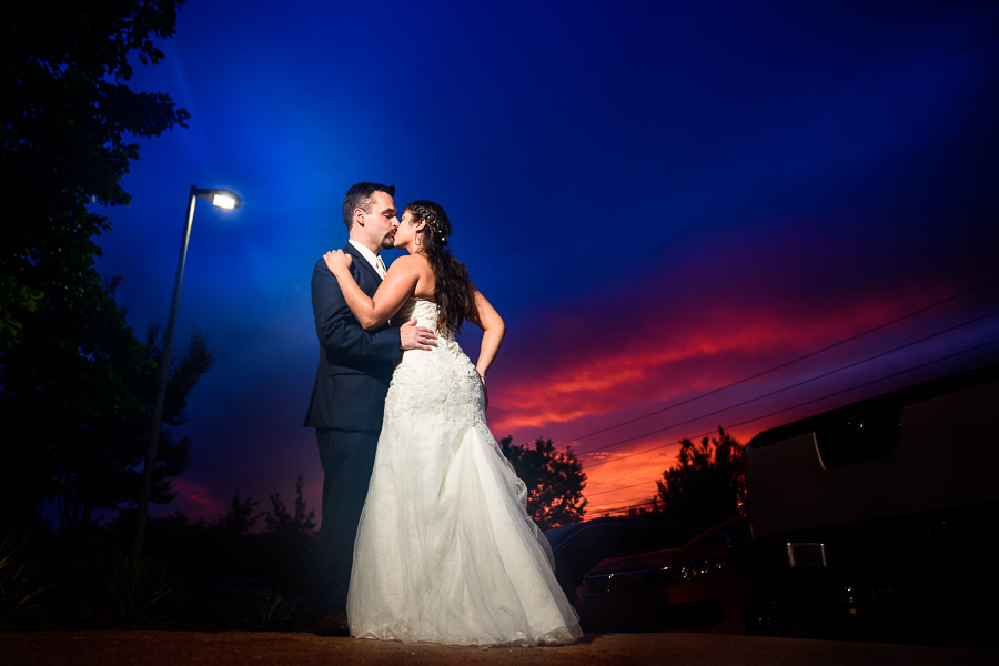 Bride and Groom kissing at sunset, Hilton Garden Inn Pensacola Airport, Pensacola Summer Wedding, Lazzat Photography
