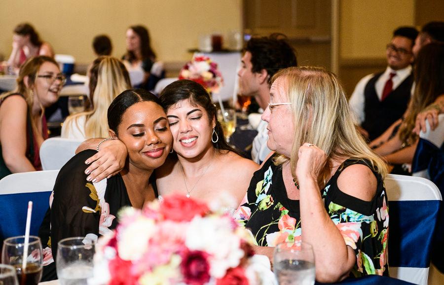 Bride hugging guests, Hilton Garden Inn Pensacola Airport, Pensacola Summer Wedding, Lazzat Photography
