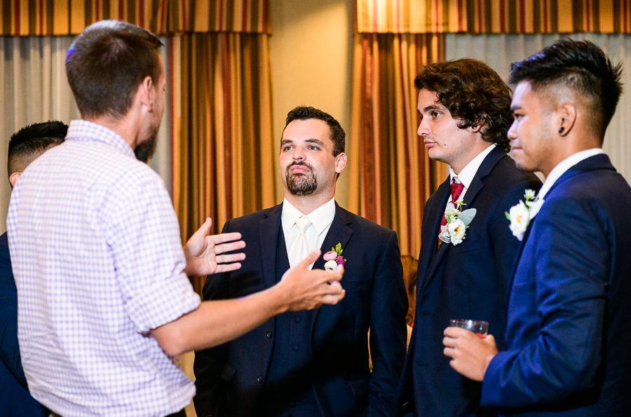 Groom talking to guests, Hilton Garden Inn Pensacola Airport, Pensacola Summer Wedding, Lazzat Photography
