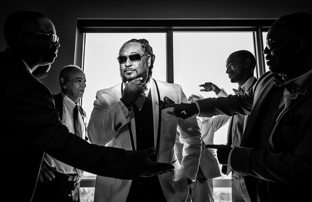 Groom posing with Groomsmen, black and white, Royal Red Destination Wedding, Florida wedding photographer, Lazzat Photography