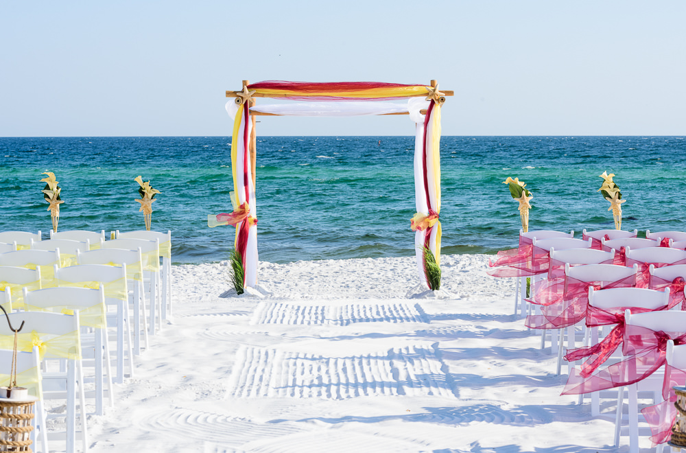 Red and yellow wedding arch on the beach, Royal Red Destination Wedding, Florida wedding photographer, Lazzat Photography