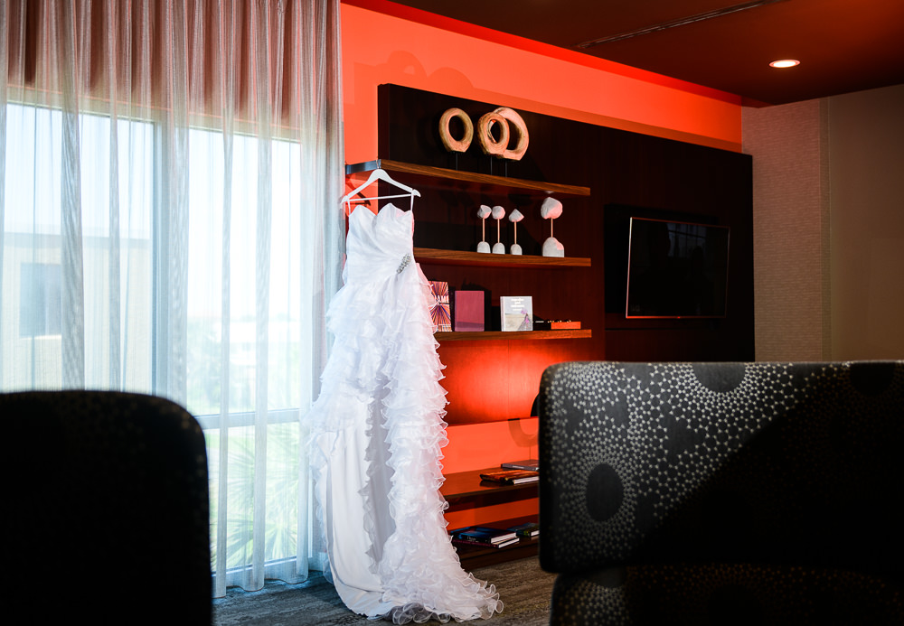 Bride's high low wedding dress hanging, Royal Red Destination Wedding, Florida wedding photographer, Lazzat Photography