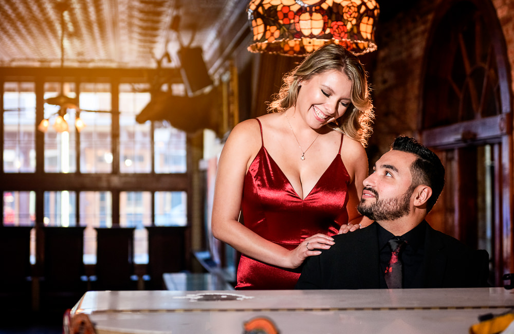 Couple at the piano bar in Seville Quarter, New Orleans Inspired Engagement Session, Long red gown, Pensacola engagement photographer, Lazzat Photography
