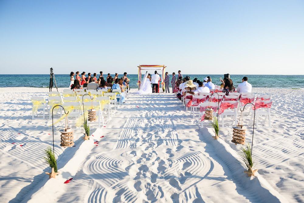 Beach wedding ceremony with raked sand, red and yellow wedding, Royal Red Destination Wedding, Florida wedding photographer, Lazzat Photography