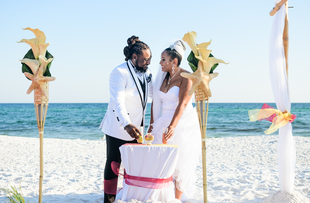 Bride and Groom doing the unity sand during their ceremony, red and yellow wedding, Royal Red Destination Wedding, Florida wedding photographer, Lazzat Photography