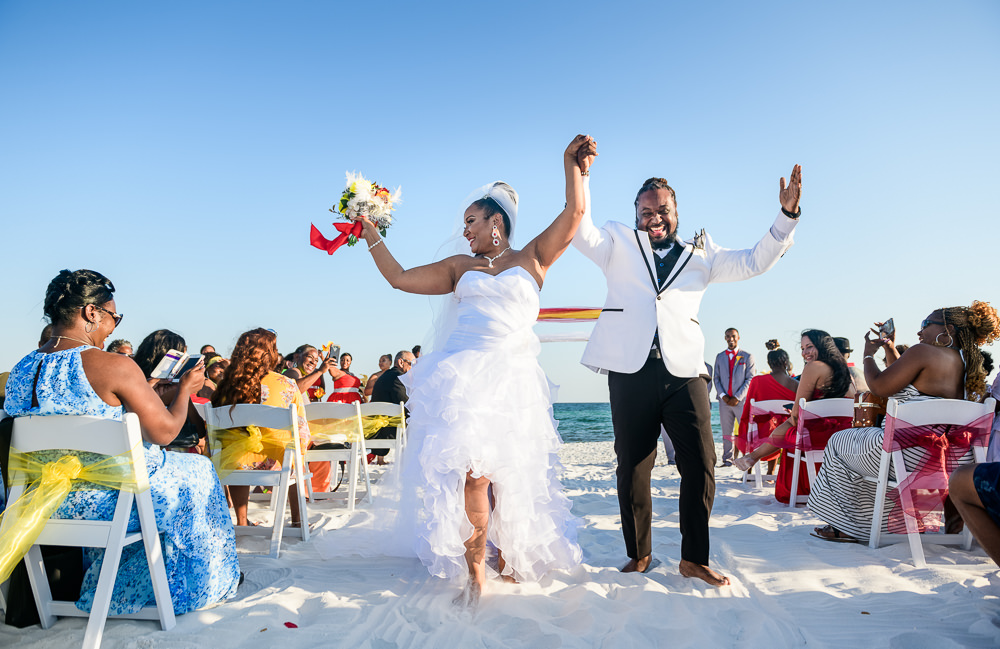 Bride and Groom dancing down the aisle, high low wedding dress, red and yellow wedding, Royal Red Destination Wedding, Florida wedding photographer, Lazzat Photography