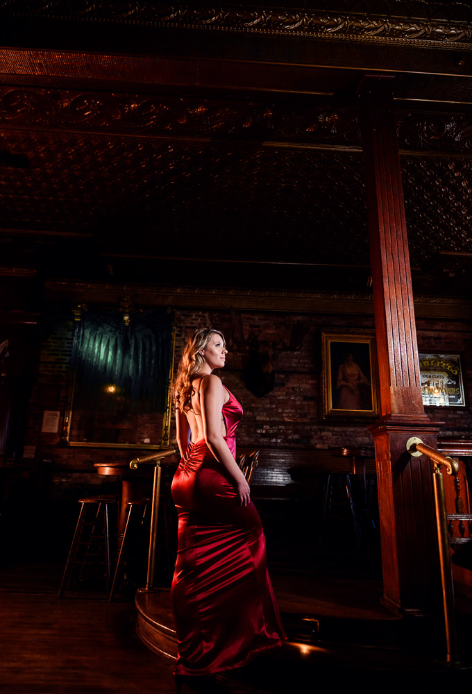 Women in long red gown posing in Seville Quarter, New Orleans Inspired Engagement Session, Long red gown, Pensacola engagement photographer, Lazzat Photography