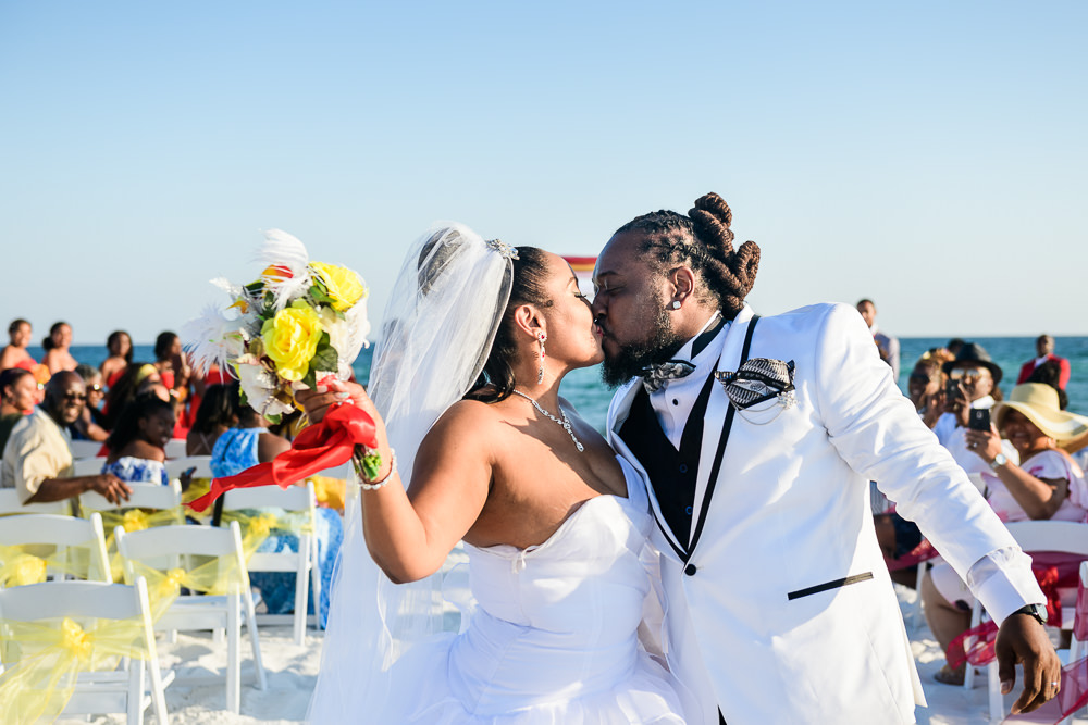 Bride and Groom kissing at the end of the aisle, red and yellow wedding, Royal Red Destination Wedding, Florida wedding photographer, Lazzat Photography