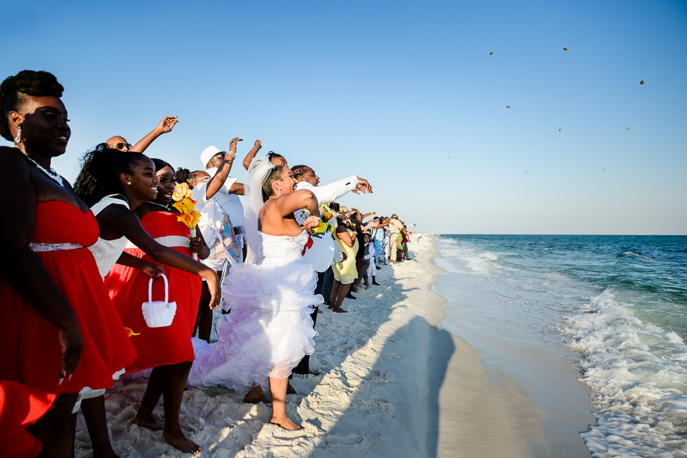 Bride and Groom doing the rock throwing ceremony with their guests, high low wedding dress, red and yellow wedding, Royal Red Destination Wedding, Florida wedding photographer, Lazzat Photography