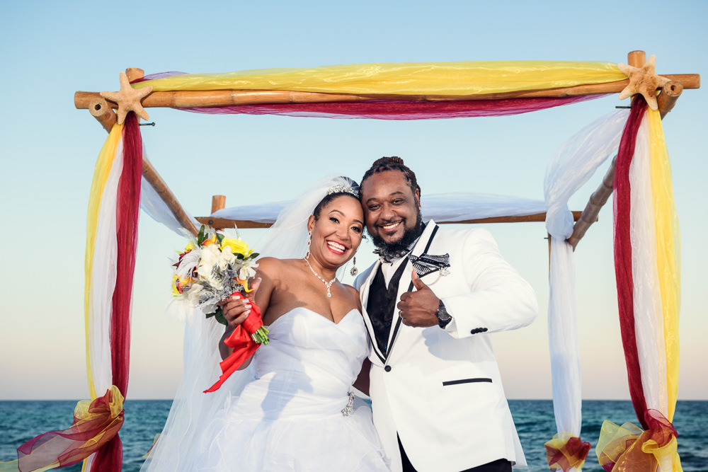 Bride and Groom thumbs up after their ceremony, red and yellow wedding, Royal Red Destination Wedding, Florida wedding photographer, Lazzat Photography